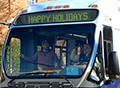 BUS IN HOLIDAY PARADE