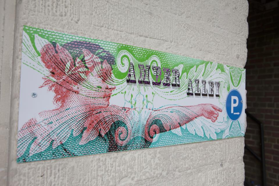 Local artist FRANKY designed custom signs for Amber Alley