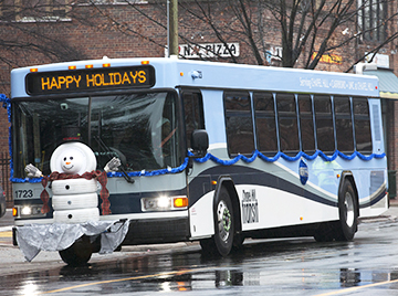 SNOWMAN ON BUS IN HOLIDAY PARADE