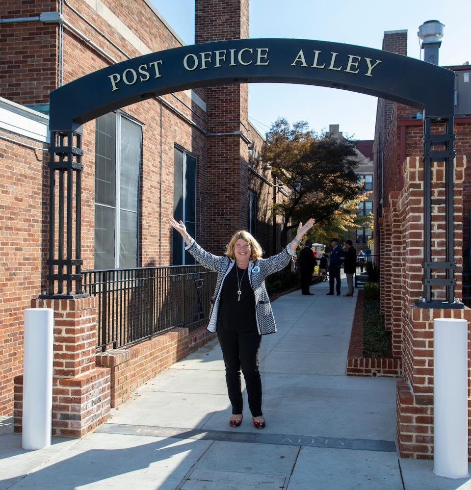 Mayor Pam Hemminger celebrates Post Office Alley's renovations November 2019